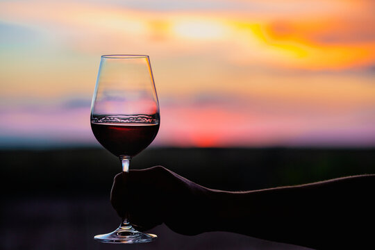 Sunset with a glass of wine.Beautiful sky with sunset with a glass of wine.A glass of wine at sunset in the mountains.Red wine. Relax.Summer concept.Summer with sunset.August. Summer vacation