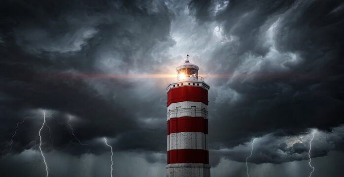 View on typhoon, hurricane, tornado, lighthouse and rain sky. Panoramic view of the stormy sky, lighthouse and dark clouds. Concept on the theme of weather, natural disasters,  tornadoes, typhoons.