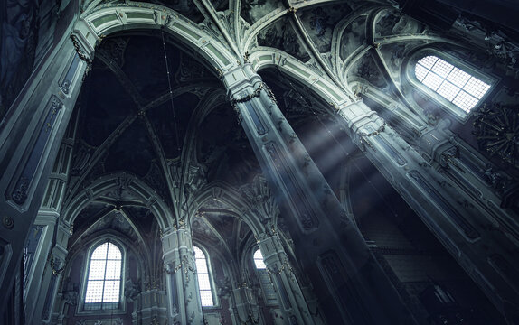 Mysterious rays of light in an old Gothic church. Inside a Christian temple. Concept on the theme of religion, faith, mysticism and history.