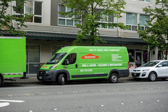 Bellevue, WA USA - circa June 2021: Street view of a Servpro van parked on the side of the road in downtown Bellevue.