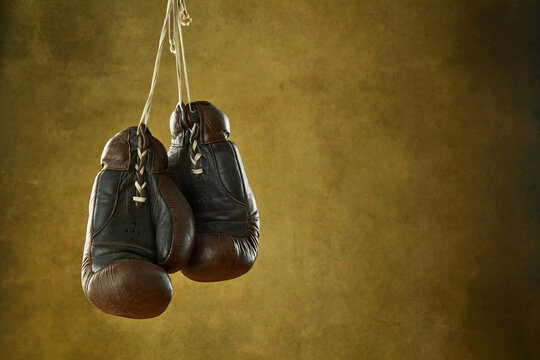 Vintage boxing gloves hanging on wall