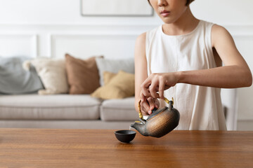 Japanese woman preparing matcha green tea