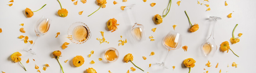 Trendy Orange or Amber wine and yellow flowers, wide composition