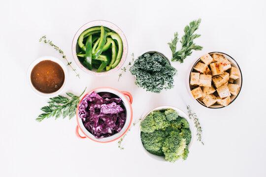 Ingredients for vegetarian salad on white background