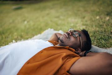 Fototapeta Adult black man, resting his eyes for a bit. obraz
