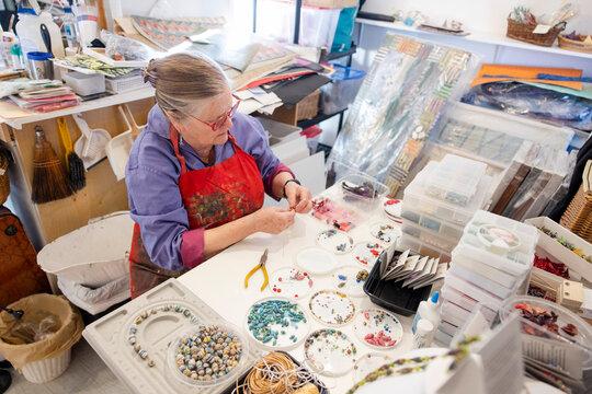 Woman making jewellery in studio