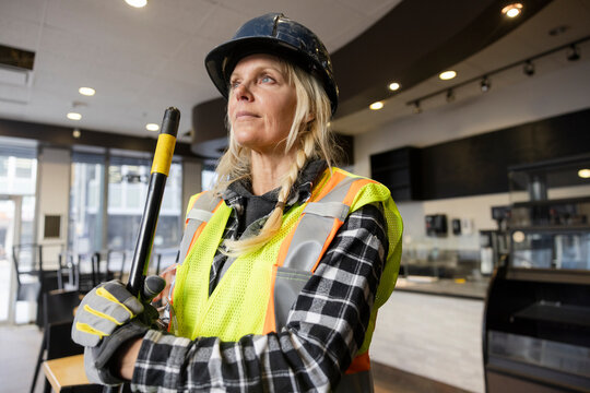 Portrait of construction worker in newly renovated cafe