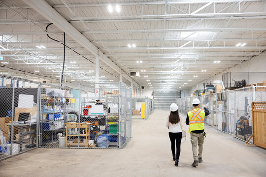 Warehouse managers walking
