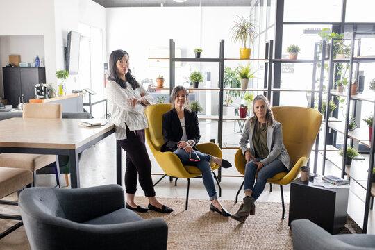 Portrait confident beautiful businesswomen in modern office