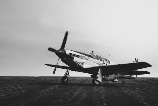 Vintage world war two fighter plane. Black and white room for copy text.