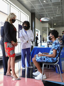U.S. first lady Jill Biden comforts a nervous patient at the COVID-19 vaccination clinic at Jackson State University in Jackson