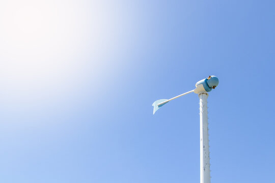 Photo from below windmill or also wind-turbine damaged by a storm in rotation to generate electricity energy on outdoor with sun and cloudy sky a background , conservation and sustainable energy conce