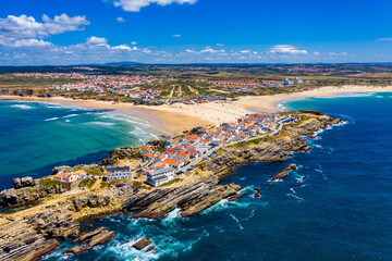 Aerial view of island Baleal naer Peniche on the shore of the ocean in west coast of Portugal. Baleal Portugal with incredible beach and surfers. Aerial view of Baleal, Portugal.
