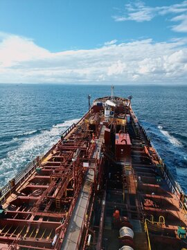 Aerial View Of A Vessel Navigating At Sea