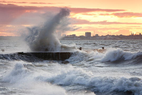 A weather storm in the Baltic Sea, waves crashing over a pier