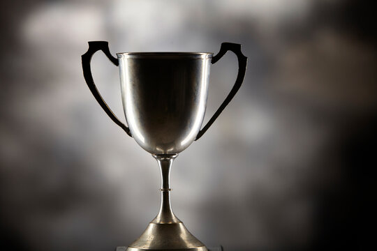 Close-up Of  Trophy On Gray Background