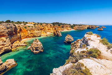 Fototapeta Praia da Marinha, beautiful beach Marinha in Algarve, Portugal. Navy Beach (Praia da Marinha), one of the most famous beaches of Portugal, located on the Atlantic coast in Lagoa Municipality, Algarve. obraz