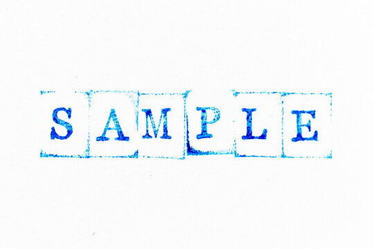 Blue color ink rubber stamp in word sample on white paper background