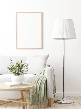 Vertical poster mockup with wooden frame in traditional living room interior with sofa, olive twigs in vase and floor lamp on empty white wall background. 3D rendering, illustration