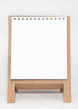 Notepad on a stand on a white background