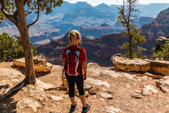 Young Female Hiker On The Rim Trail Near Yavapai Point, Grand Canyon National Park, Arizona, USA