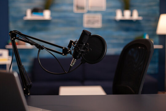 Empty podcast room with professional microphone in vlogger home studio in living. Influencer recording social media content with production microphone, digital web internet streaming station.
