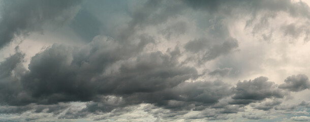 Fototapeta Panorama view of overcast sky. Dramatic gray sky and white clouds before rain in rainy season. Cloudy and moody sky. Storm sky. Cloudscape. Gloomy and moody background. Overcast clouds. obraz
