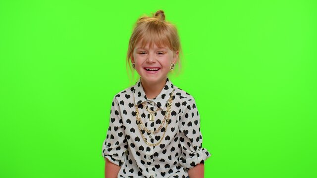 Smiling blonde kid child in shirt laughing out loud after hearing ridiculous anecdote, funny joke, feeling carefree amused, positive people lifestyle on chroma keybackground. Teenager children girl