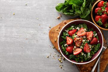 Obraz Seasonal salad with strawberry, spinach and pistachio - fototapety do salonu