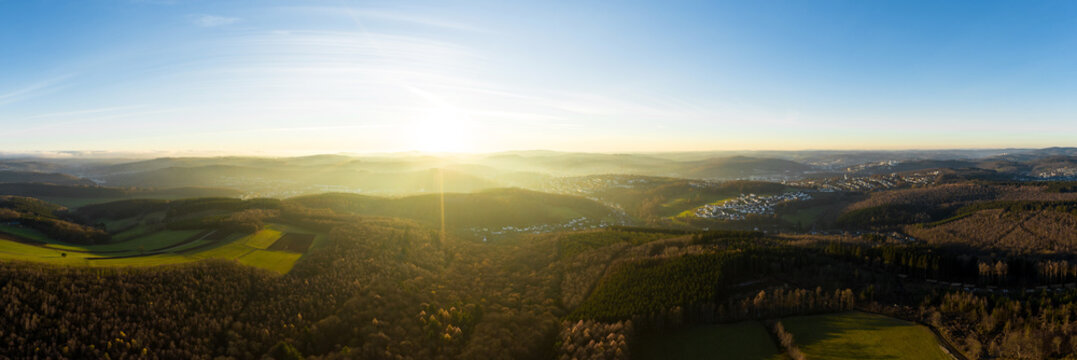 the siegerland forest and city from above in germany in autumn as a high definition panorama