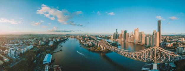 Fototapeta Panorama sunrise aerial shot of Brisbane, the Story Bridge and the Brisbane River obraz