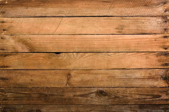 Weathrered old wooden planks background with nails top view.