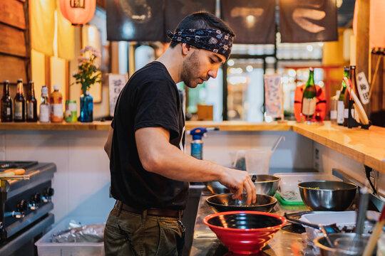 Chef cooking in ramen bar