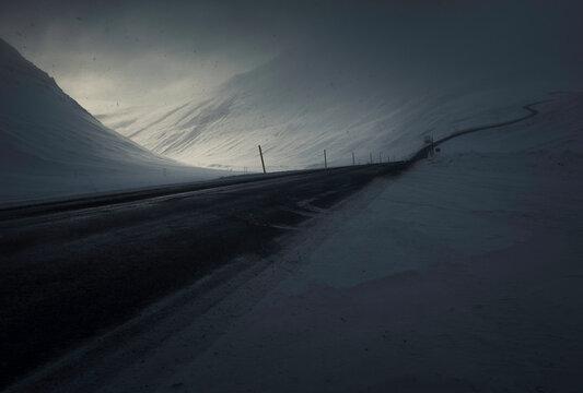 Countryside road near snowy hills