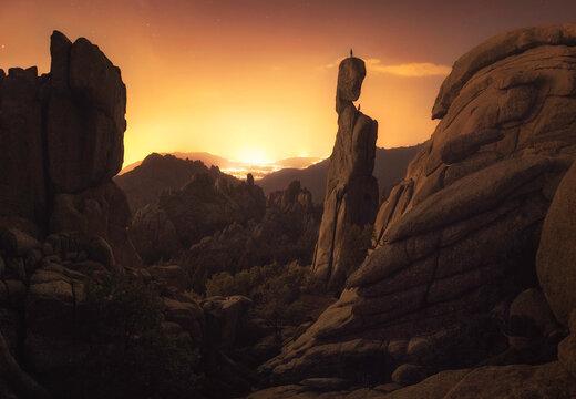 Climbers climbing an awesome rock at sunset