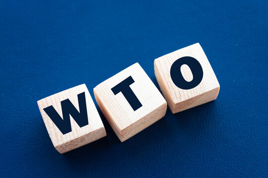 WTO abbreviation on wooden cubes with letters. World Trade Organization. Business concept