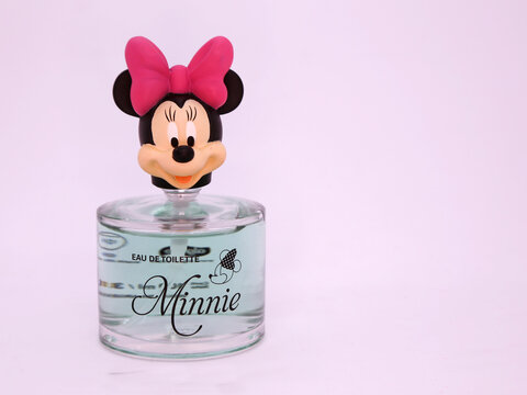 Minnie Mouse Eau de Toilette. Disney brand eau de toilette. Cartoon characters from Walt Disney Pictures Studios. Minnie is Mickey Mouse's girlfriend. Glass bottle of eau de cologne. Isolated white.