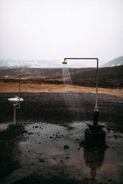 Vintage shower between wild lands near mountains