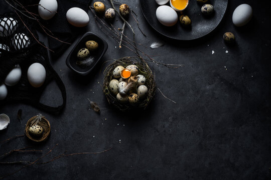 Raw whole and broken chicken and quail eggs