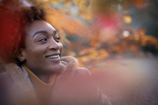 Portrait happy young woman in autumn park