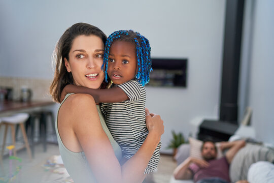 Beautiful mother and toddler daughter at home