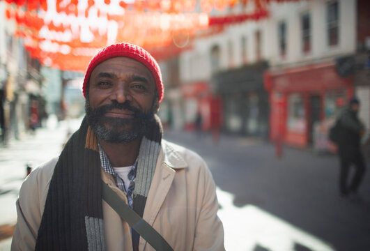 Portrait happy handsome man on sunny city street