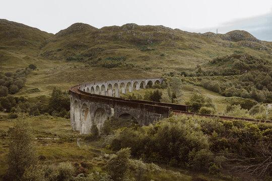 Old train track along ancient arch bridge