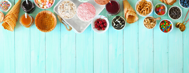 Fototapeta Summer ice cream buffet with assorted of flavors and sweet toppings. Above view table scene on a blue wood background. obraz