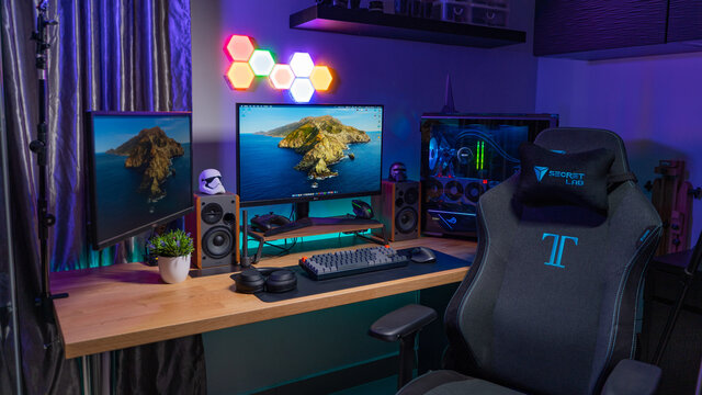 KL, MALAYSIA - June 26th, 2021 :                     A Work From Home Office Setup. HTPC, Hackintosh PC & Gaming PC rig with liquid cooling setup and full RGB light inside