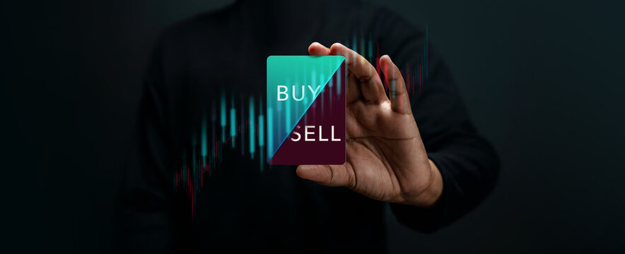 Stock Market Share Investment Strategy Concept. Investor Holding a Card to Decision for Selling or Buying. Take or Lose Profit. surrounded by Stock Marketing Graph. Dark tone