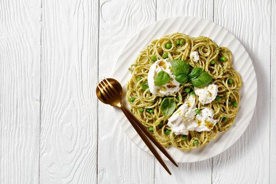 pesto spaghetti with green peas and burrata cheese