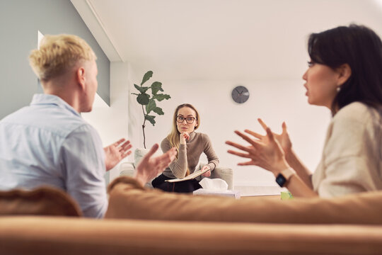 Couple discussing problems during psychotherapy session