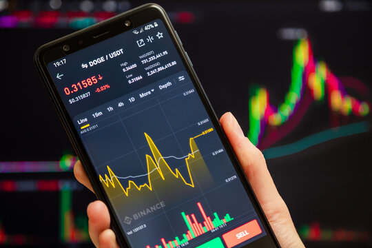 Ukraine, Odessa - June, 1 2021: Trading pair DOGE USDT at Binance mobile app running at smartphone screen with a trading page at background. Binance one of the world's leading cryptocurrency exchange