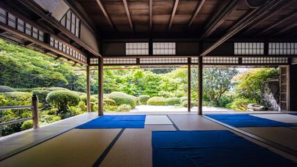 Fototapeta A Fresh Green Garden Seen From The Tatami Room. obraz